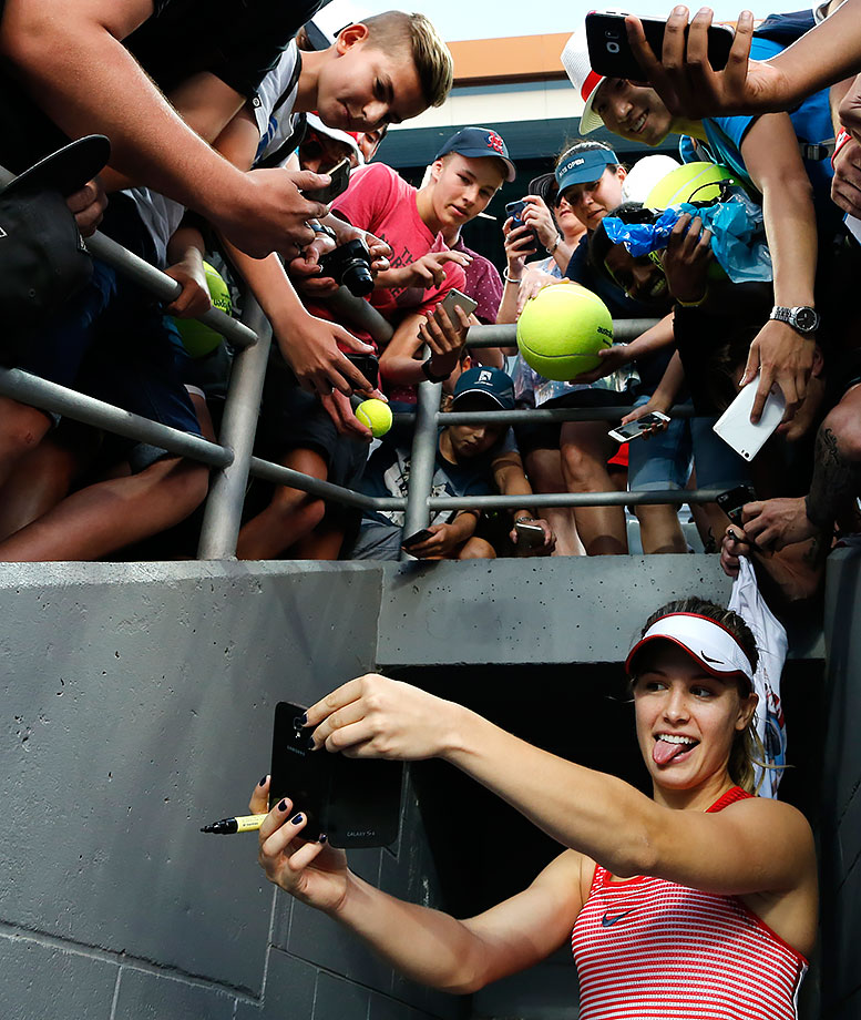 Eugenie Bouchard takes a selfie for a fan after defeating Aleksandra Krunic at the Australian Open.