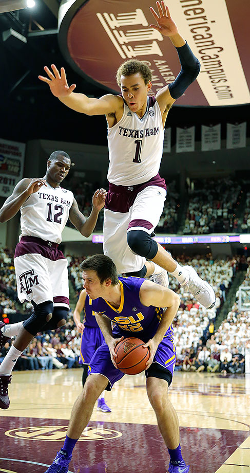 LSU's Darcy Malone takes a knee in the back from Texas A&M's DJ Hogg.