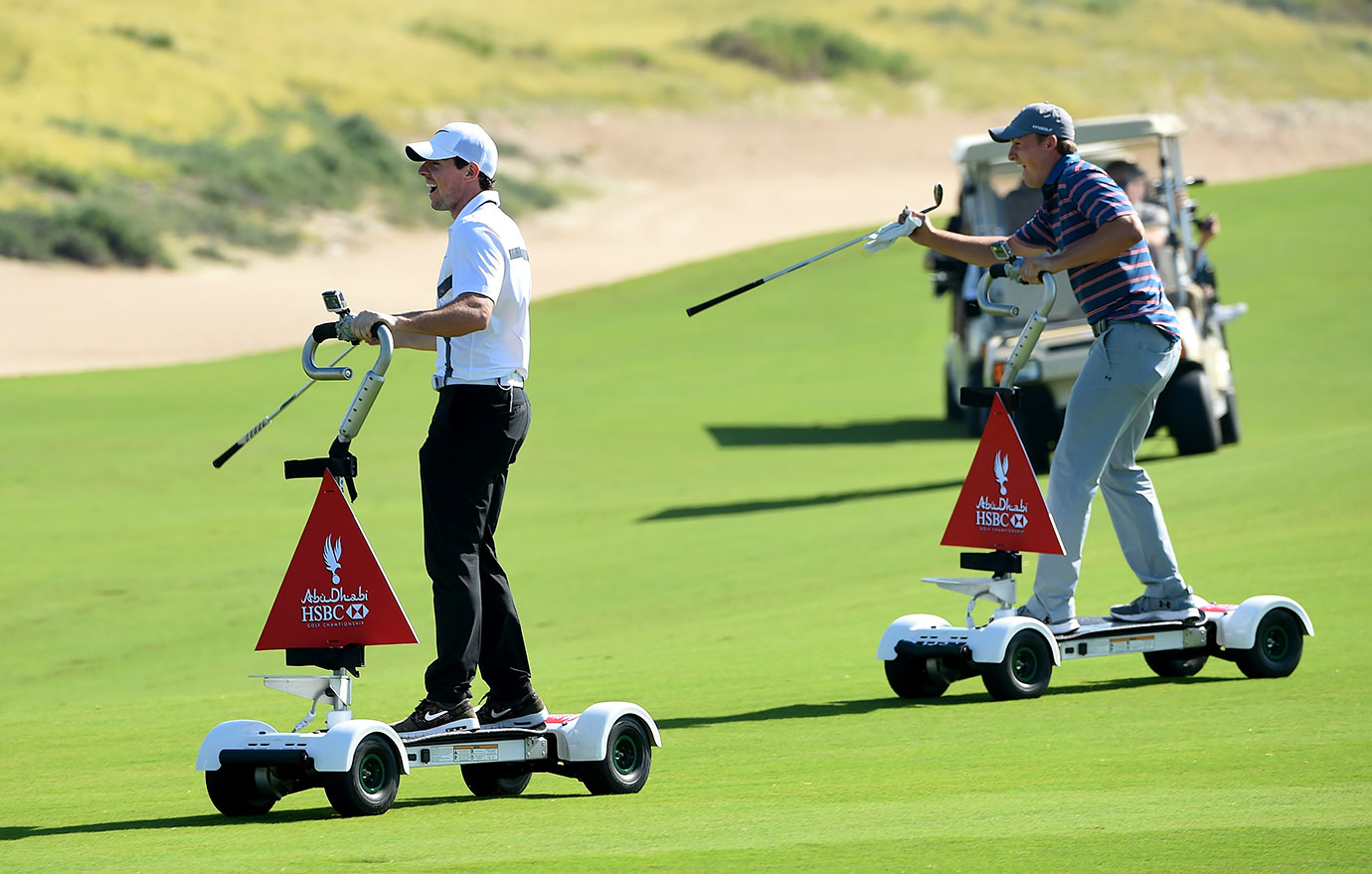 Rory McIlroy and Jordan Spieth look ready to joust as they ride GolfBoards during the Rider Cup Desert Challenge in Abu Dhabi.