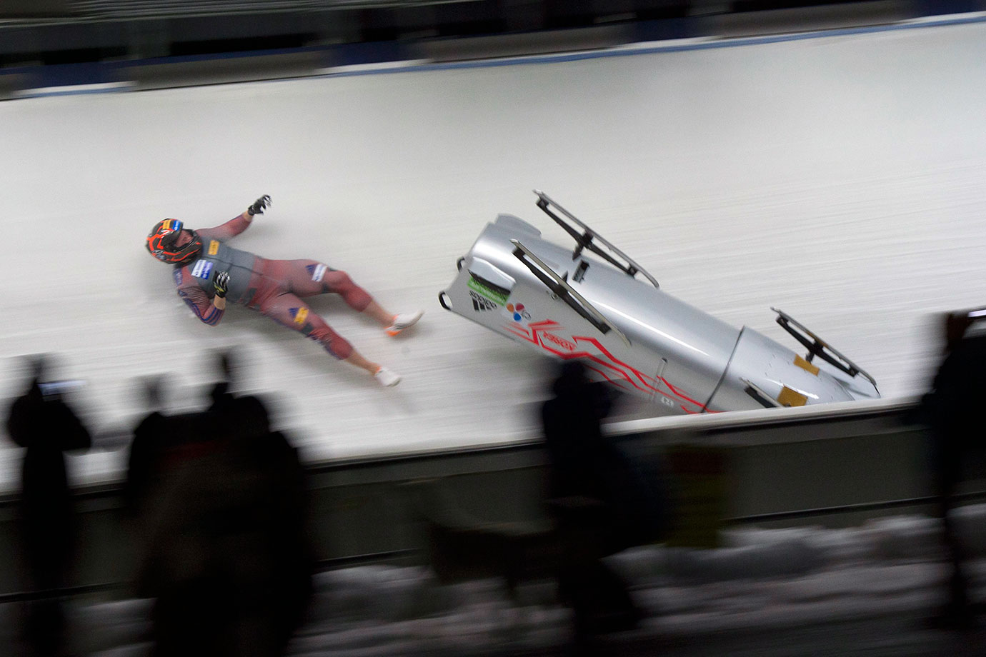 South Korea brakeman Kim Keun-bo falls out of his sled during the second run of the World Cup two-man bobsled in Whistler, Canada.