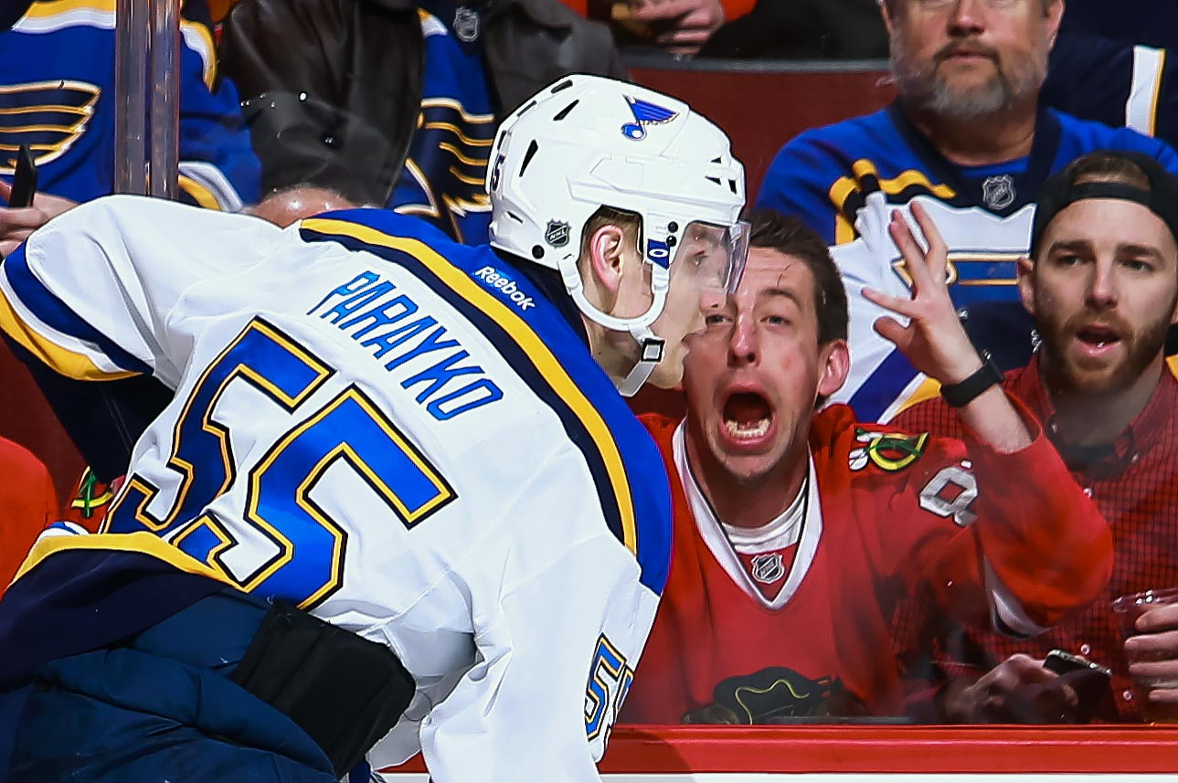 One Chicago Blackhawks fan appears desperate to get the attention of St. Louis Blues defenseman Colton Parayko at the United Center in Chicago.