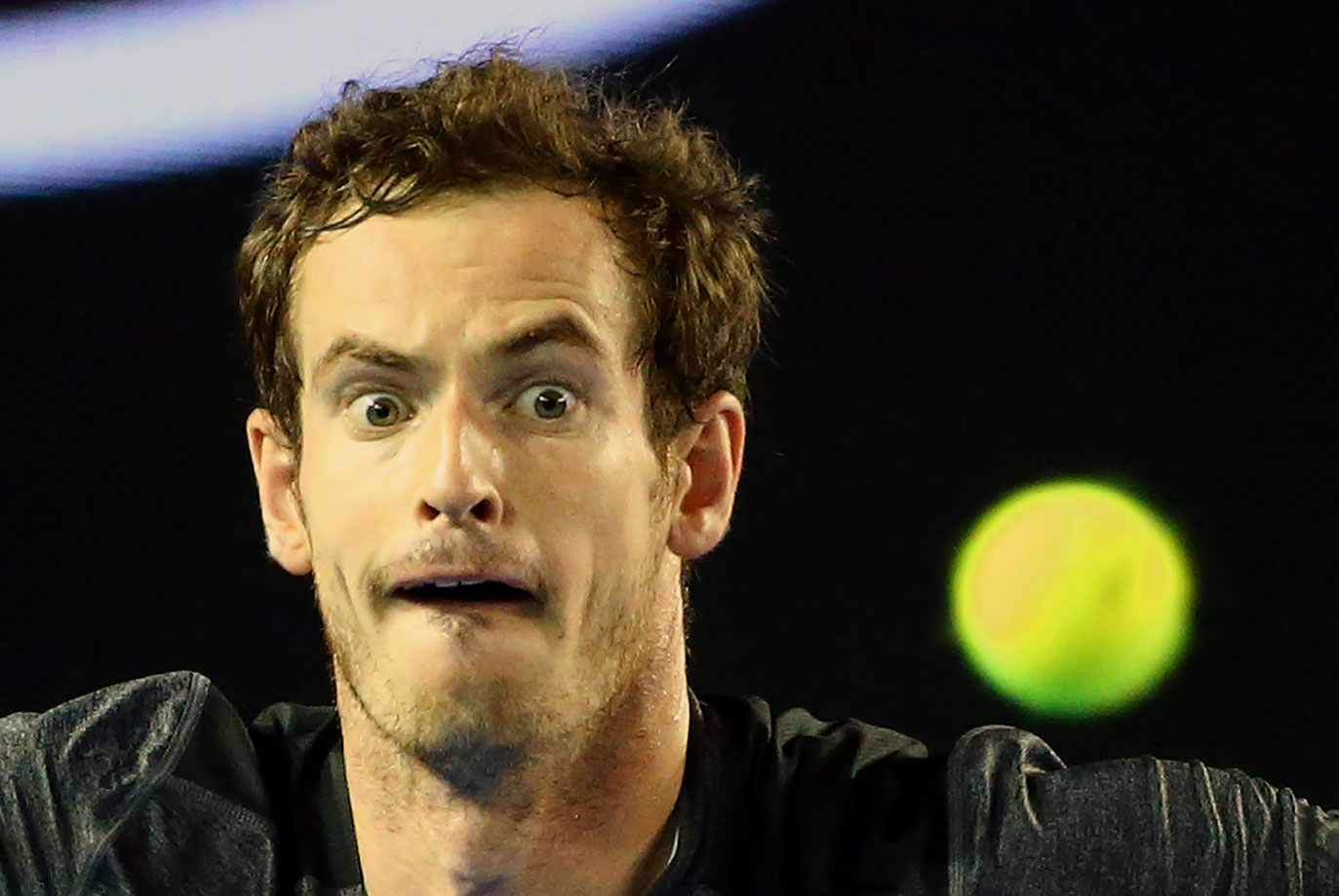 Andy Murray watches the ball during his match against Bernard Tomic at the Australian Open in Melbourne.