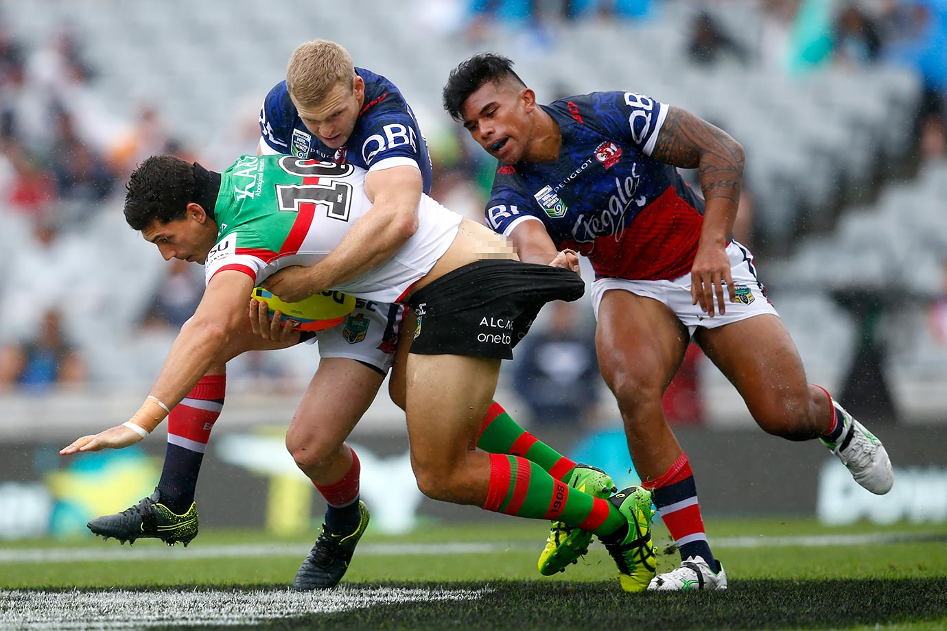 Kyle Turner is tackled during the 2016 Auckland Nines match between the Rabbitohs and the Roosters at Eden Park in Auckland, New Zealand.