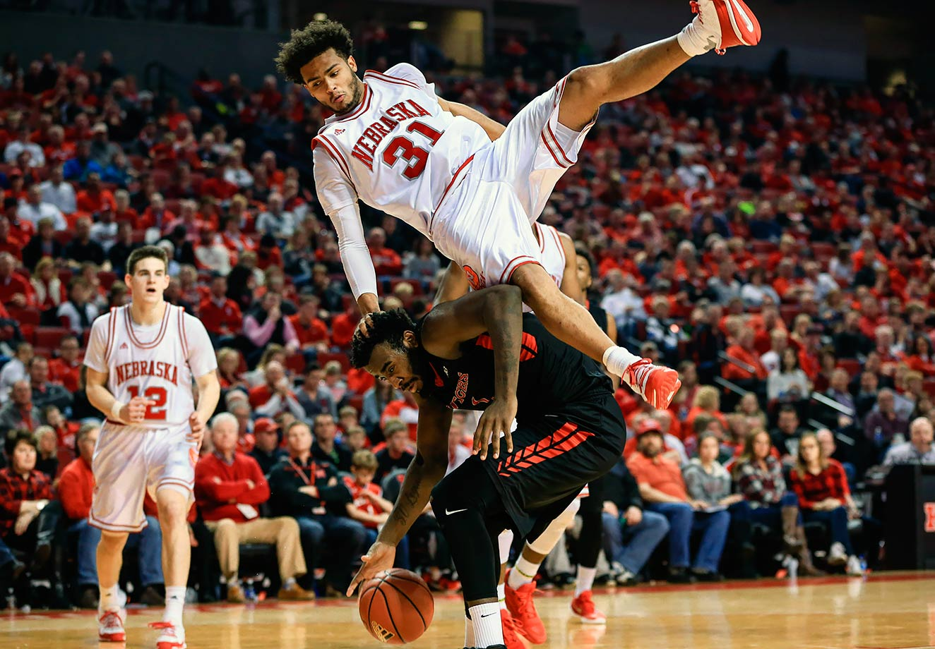 Shavon Shields rolls off the back of D.J. Foreman during a game between Nebraska and Maryland at Pinnacle Bank Arena in Lincoln, Neb.
