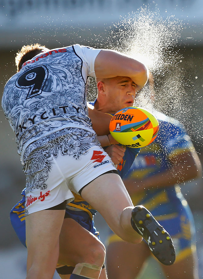 Cameron King is tackled by Henare Wells during the final match between the New Zealand Warriors and the Parramatta Eels at the 2016 NRL Auckland Nines at Eden Park in Auckland, New Zealand.