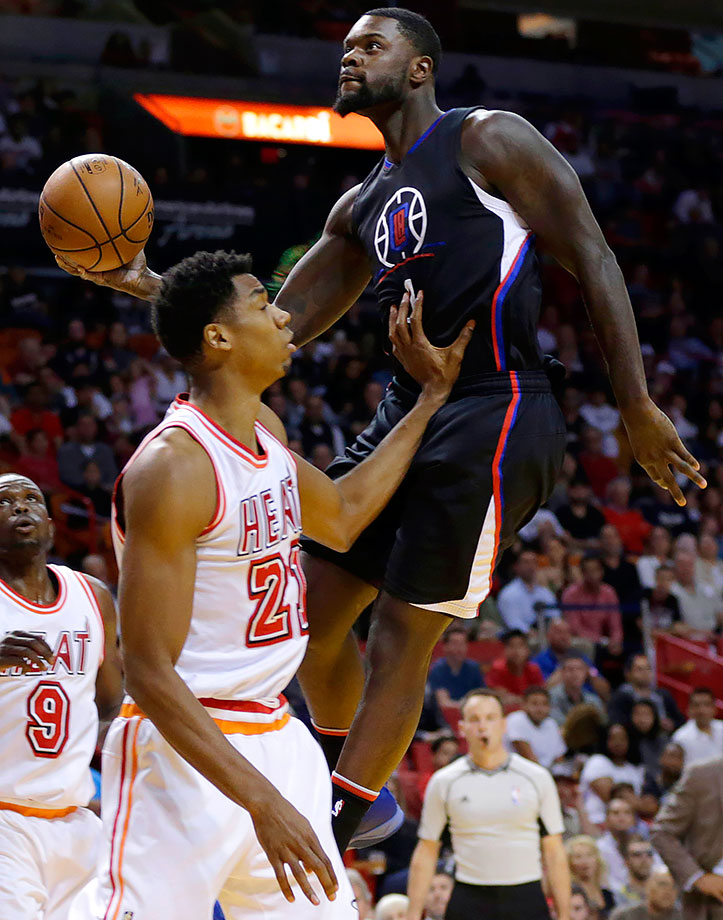 Lance Stephenson goes to the basket against Hassan Whiteside during a game between the Los Angeles Clippers and Miami Heat at American Airlines Arena in Miami.