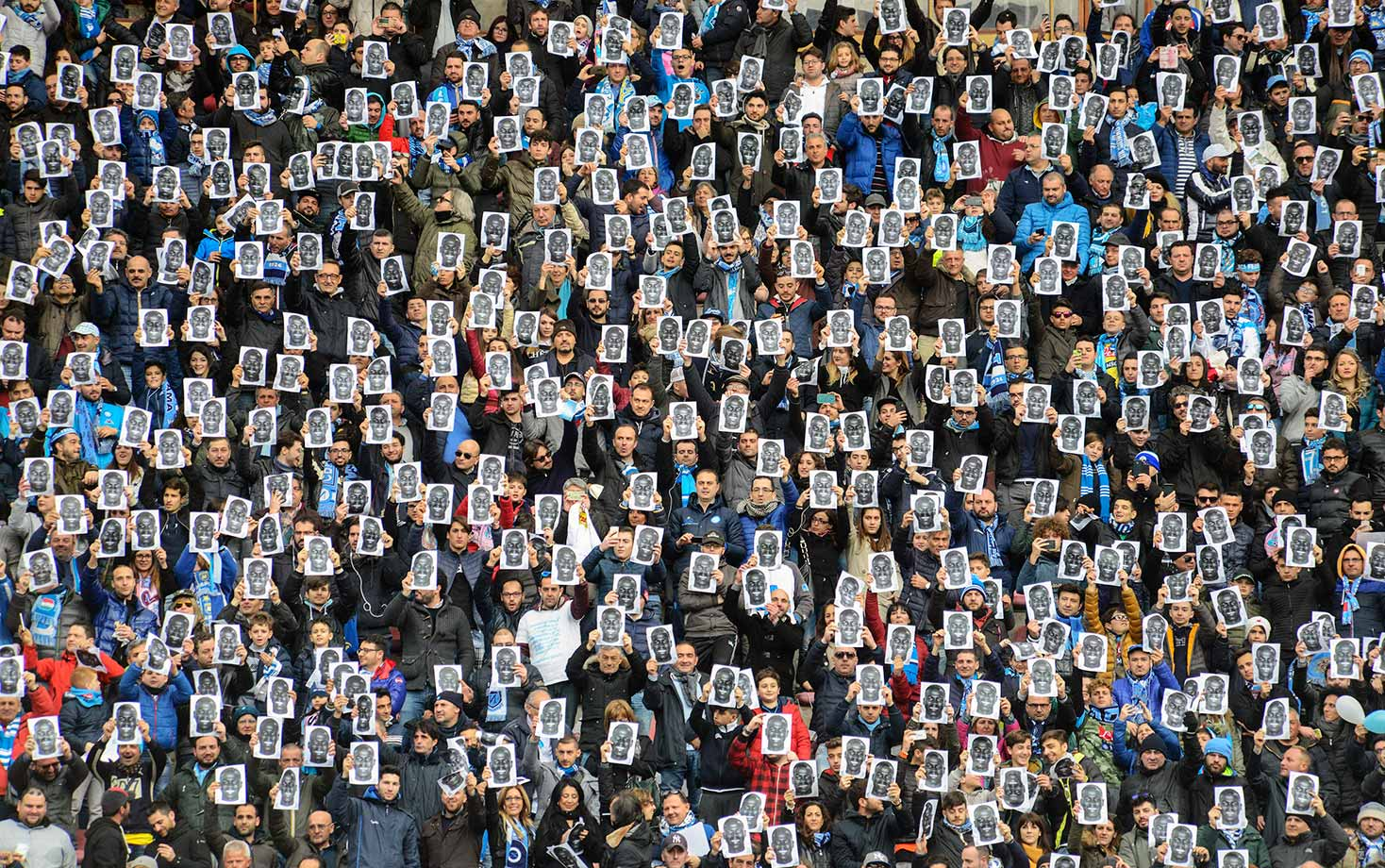 Fans of Napoli's Kalidou Koulibaly hold up his portrait ahead of a Serie A match between Napoli and Carpi at Stadio San Paolo in Naples, Italy.