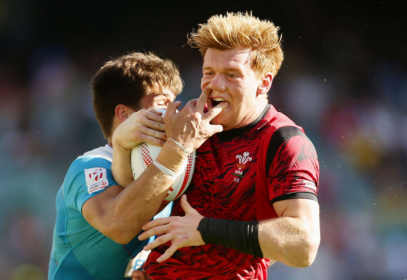 Sam Cross is tackled by German Davydov during the 2016 Sydney Sevens Shield Final match between Wales and Russia at Allianz Stadium in Sydney, Australia.