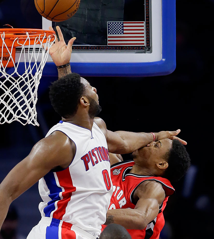 Andre Drummond fouls DeMar DeRozan during a game between the Detroit Pistons and Toronto Raptors at The Palace of Auburn Hills, Mich.