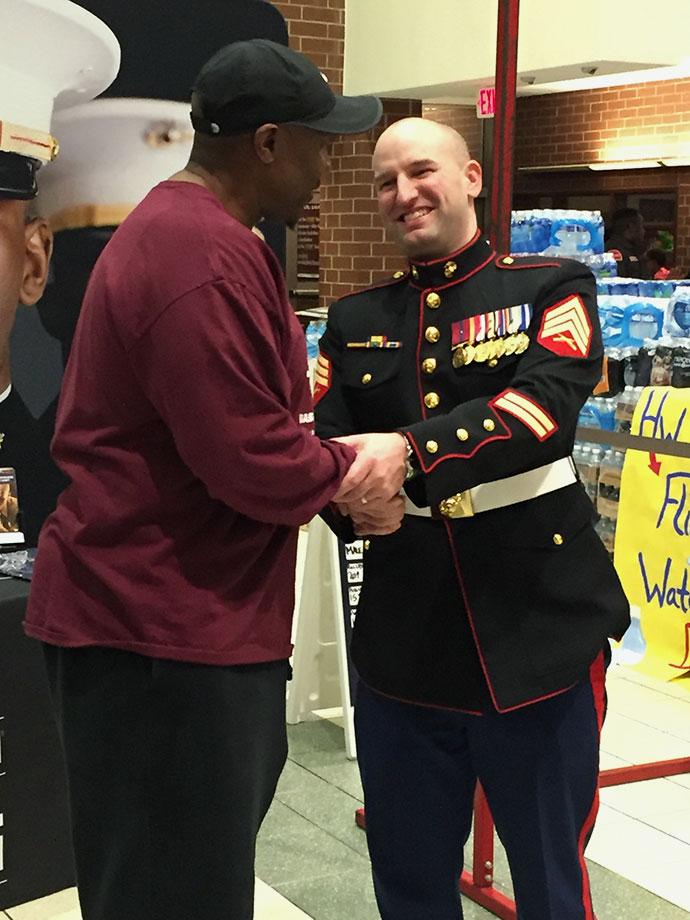 Sgt Luke Brooks of the U.S. Marine Corps (right) greets Will Smith, a former Marine, who founded Neighborhood United Maxiumum Effort Now (N.U.M.E.N.), a youth basketball program that serves the Harper Woods area. Smith nominated Daijon (no relation) for SI's High School Athlete of the Month honor after reading about the monthly series in the magazine.