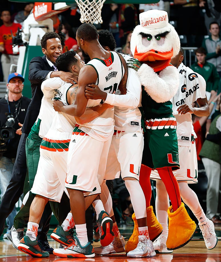 Miami celebrates their 65-63 win against Pittsburgh at BankUnited Center in Coral Gables, Fla.