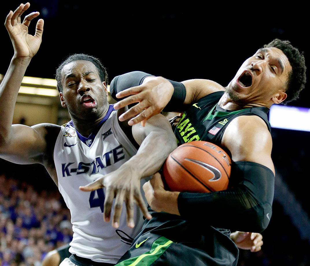 Kansas State's D.J. Johnson and Baylor's Ishmail Wainright battle for a rebound during the second half of their game in Manhattan, Kans.
