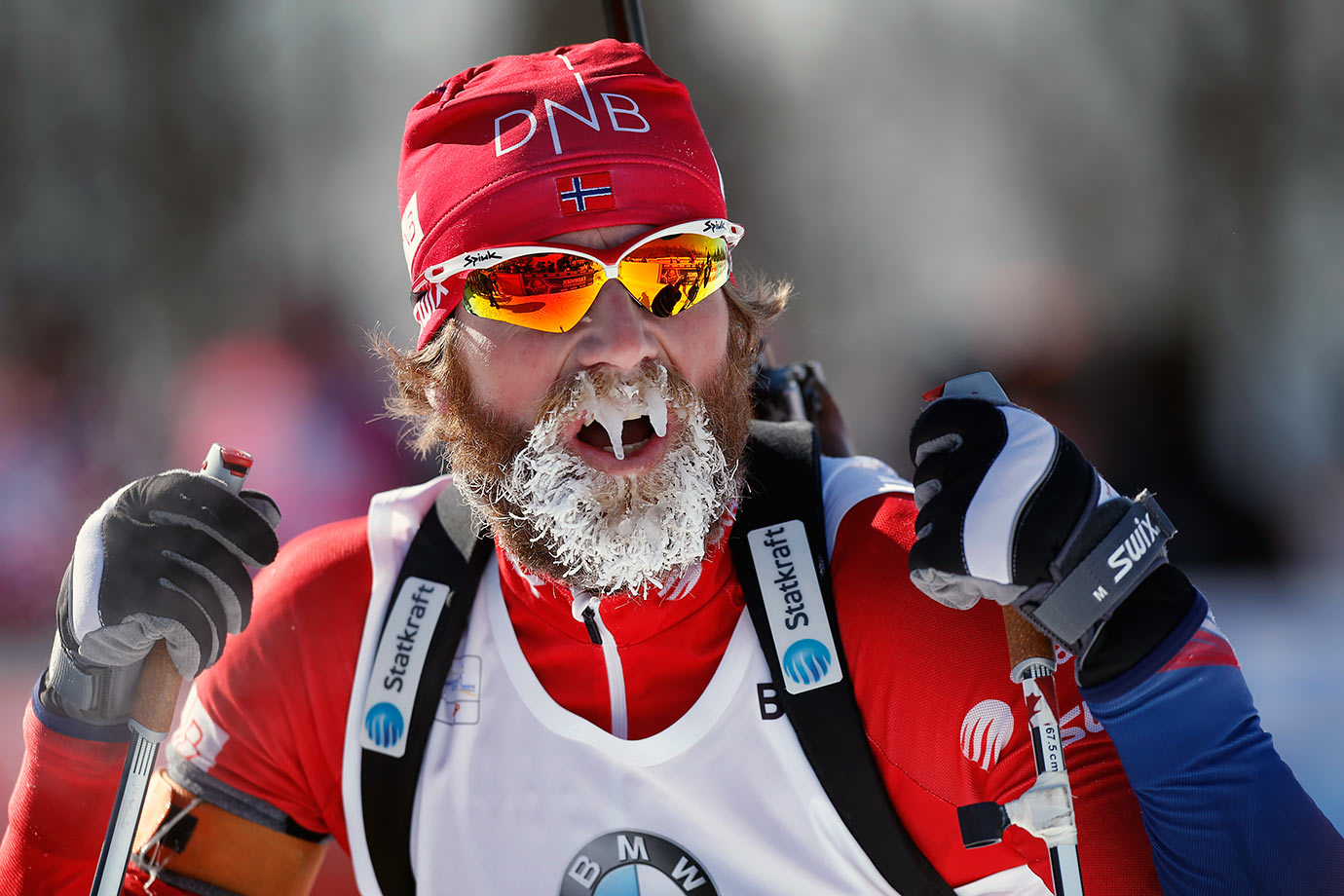 Alexander Os of Norway catches his breath after competing in 0-degree F (-18 C) temperature in the 12.5 km pursuit competition during the World Cup Biathlon in Presque Isle, Maine.