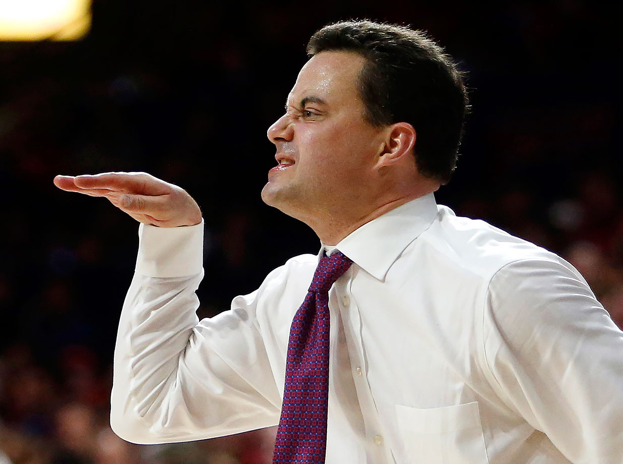 "Arizona coach Sean Miller appears to ""walk like an Egyptian"" as he reacts to a foul call during the first half against UCLA in Tucson, Ariz."