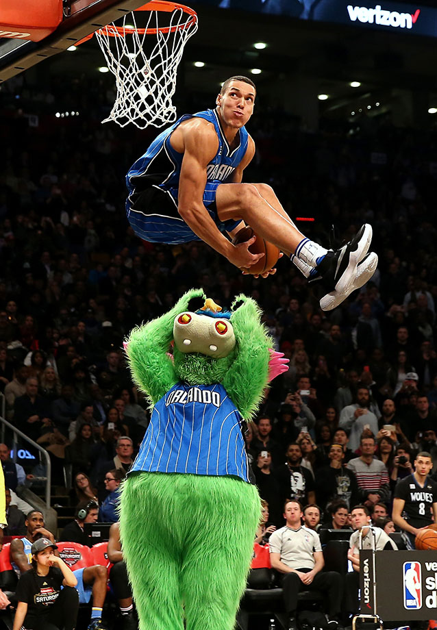 Aaron Gordon of the Orlando Magic dunks over team mascot Stuff in the Slam Dunk Contest during NBA All-Star Weekend 2016 in Toronto.