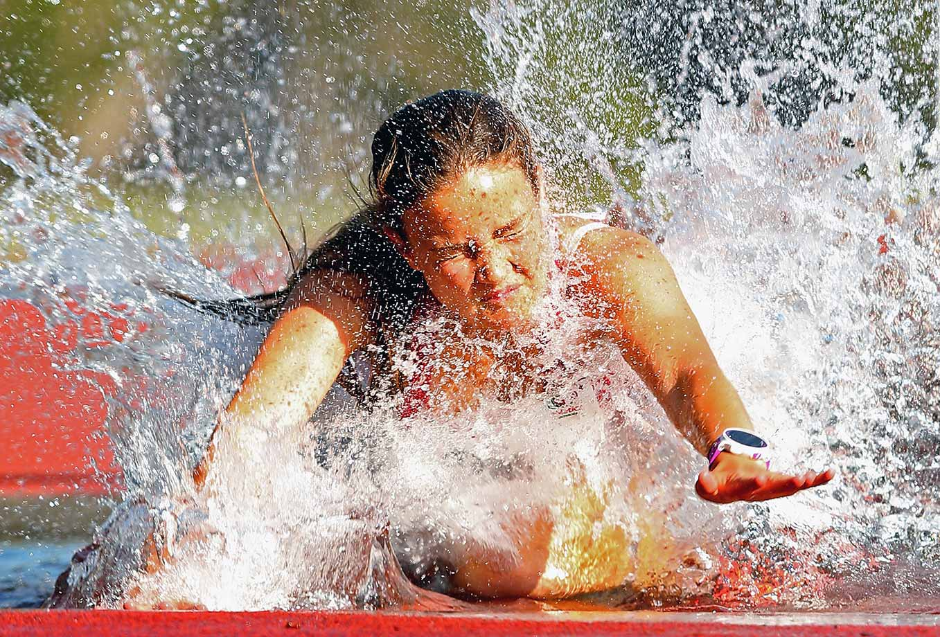 Ebony Webb of Tasmania trips into the water in the Women's 2000 meter Steeplechase during the Briggs Athletics Classic in Hobart, Australia.