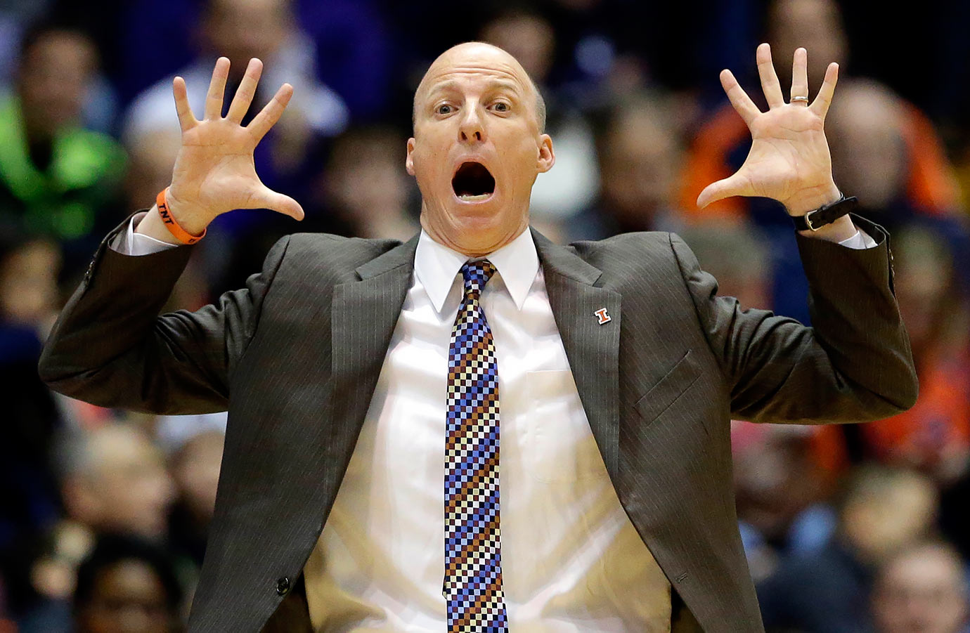 Illinois head coach John Groce reacts as he watches his team during the first half of their game against Northwestern in Evanston, Ill.