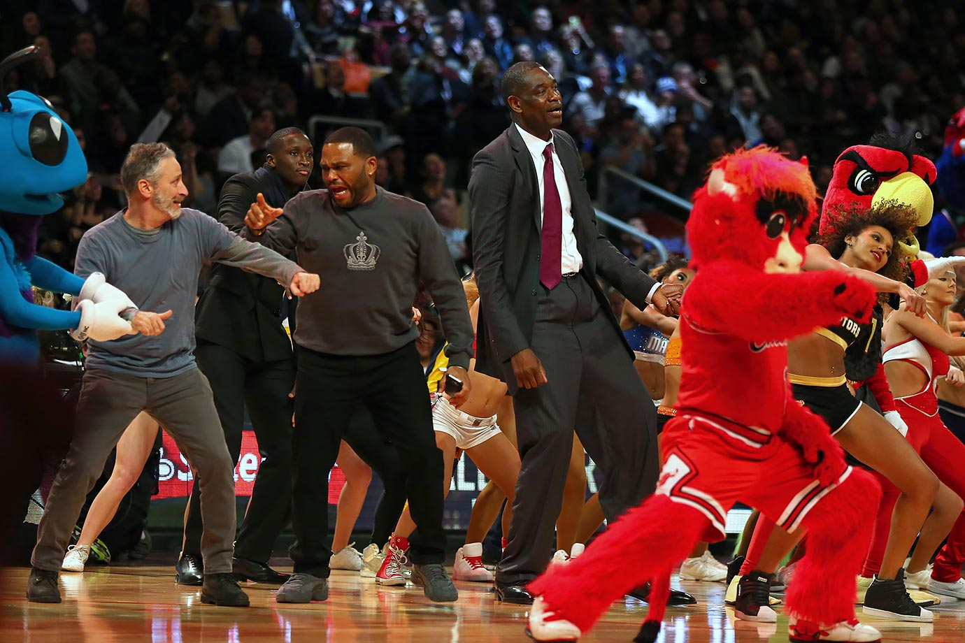 Jon Stewart, Victor Oladipo, Anthony Anderson and Dikembe Mutombo dance on the court during NBA All-Star Weekend 2016 in Toronto.