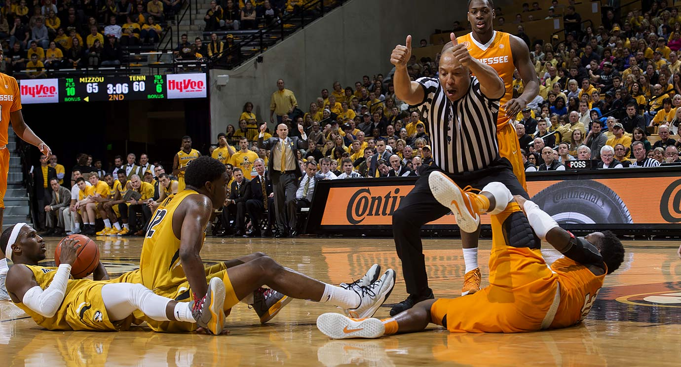 Referee Glenn Tuitt calls a jump ball as Missouri and Tennessee players lay on the court during the second half of their game in Columbia, Mo.
