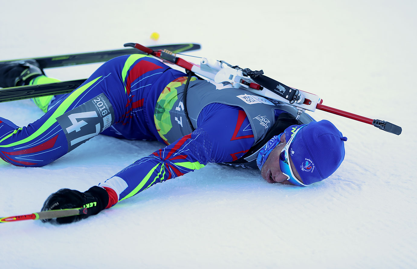 Emilien Claude (FRA) collapses after winning the Men's 7,5km Sprint  at the Hafjell Olympic Slope on Feb. 14, 2016 during the Winter Youth Olympic Games in Lillehammer, Norway.