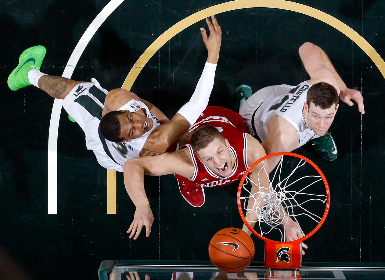 Indiana's Max Bielfeldt reacts to a rebound against Michigan State's Alvin Ellis III and Matt Costello during the second half of their game in East Lansing, Mich.