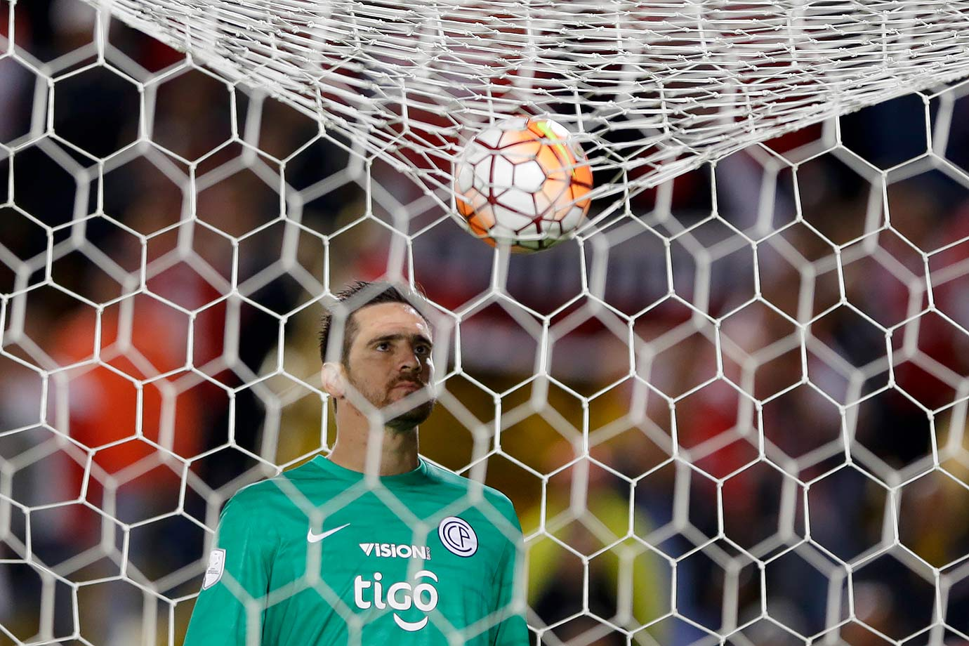 Cerro Porteño goalkeeper Anthony Silva looks at a ball that landed on top of the goalie's net after an attempt to score by Santa Fe during a Copa Libertadores match in Bogota, Colombia.