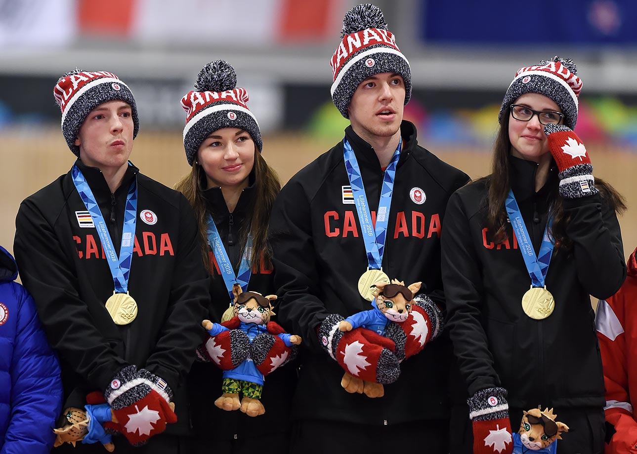 Sterling Middleton, Karlee Burgess, Tyler Tardi and Mary Fay (CAN) stand on the medal podium after winning the Gold Medal Game of the Curling Mixed Team Finals at the Lillehammer Curling Hall on Feb. 17, 2016 during the Winter Youth Olympic Games in Lillehammer, Norway.