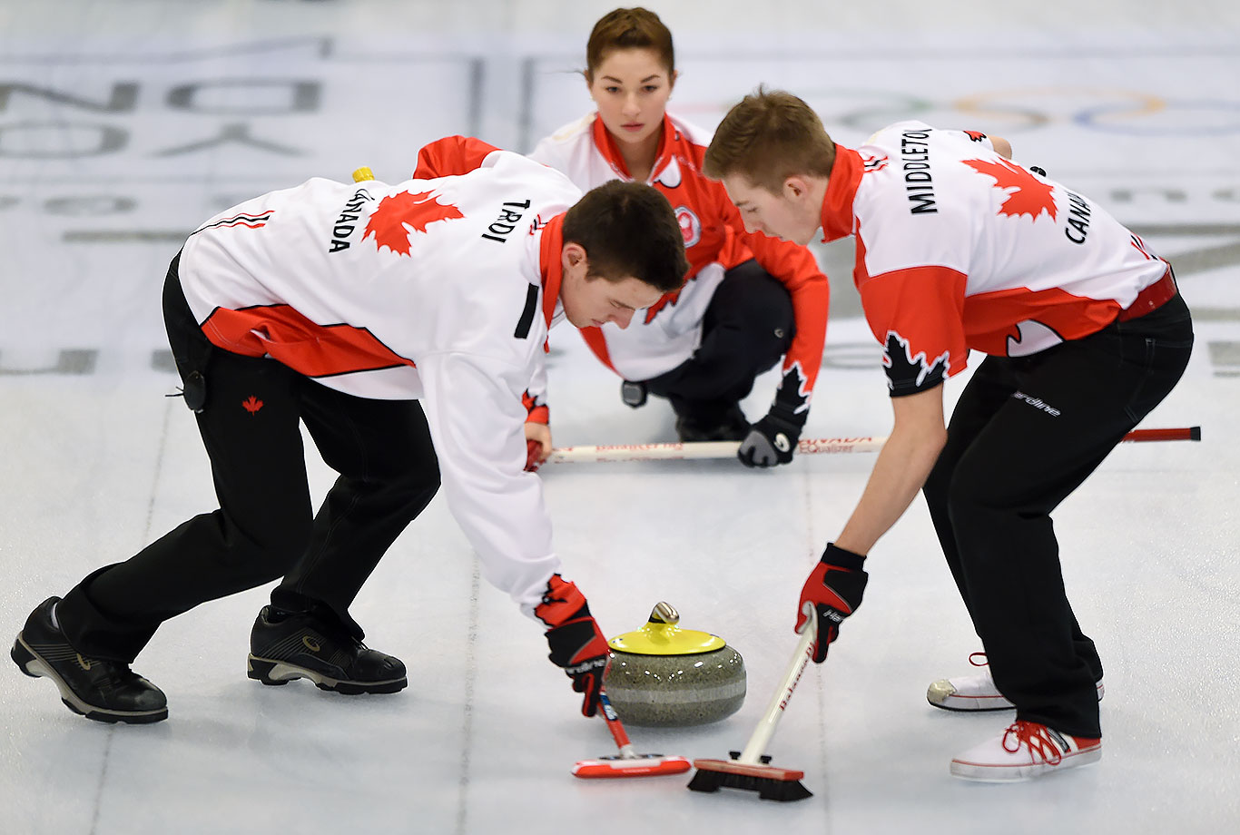 Tyler Tardi, Karlee Burgess and Sterling Middleton (CAN) compete in the Gold Medal Game of the Curling Mixed Team Finals at the Lillehammer Curling Hall on Feb. 17, 2016 during the Winter Youth Olympic Games in Lillehammer, Norway.