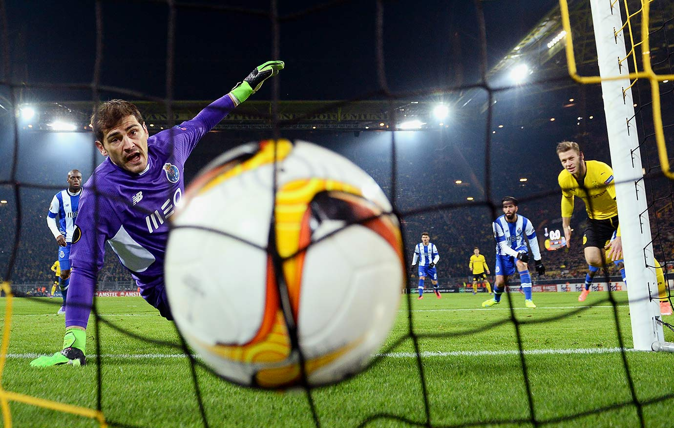 FC Porto's Iker Casillas watches the ball at the back of the net as Borussia Dortmund's Lukasz Piszczek (right) heads the ball to score his team's first goal during the UEFA Europa League round of 32 first leg match in Dortmund, Germany.