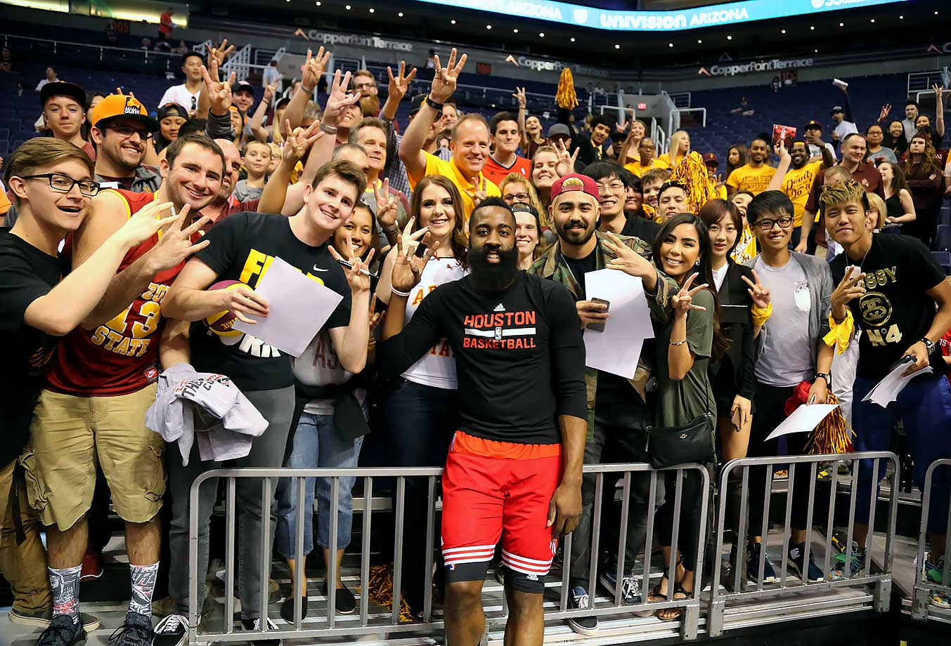 Houston Rockets shooting guard and Arizona State alumn James Harden poses with ASU fans before the Rockets game against the Phoenix Suns in Phoenix, Ariz.