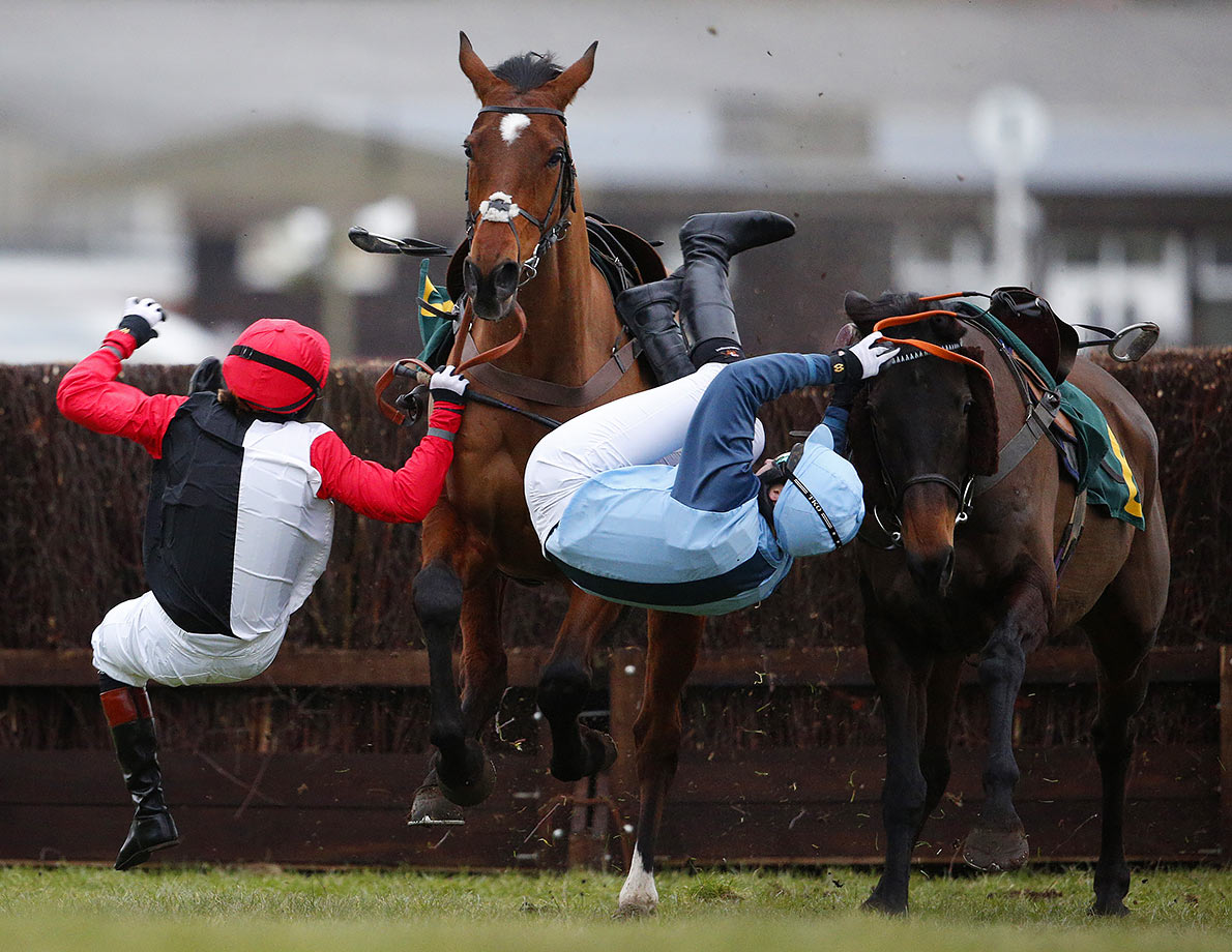 "Victoria Pendleton, riding Pacha Du Polder, and Carey Williamson, riding Baltic Blue, are thrown from their horses during The Betfait Switching Saddles ""Grassroots"" Fox Hunters' Steeple Chase in Fakenham, England."