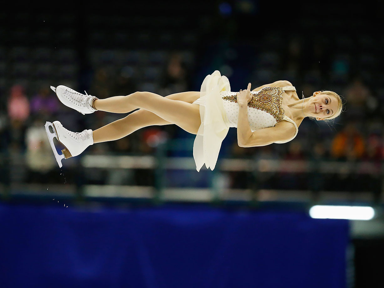 Alexa Scimeca soars through the air as she performs with partner Chris Knierim during the Pairs Free Skating on day three of the ISU Four Continents Figure Skating Championships in Taipei City, Taiwan.