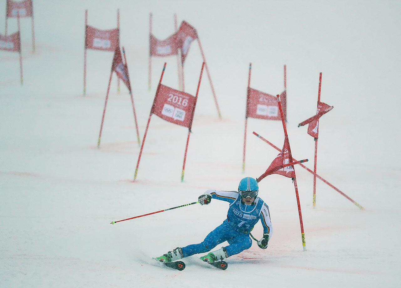 Jonas Stockinger (GER) competes in the Alpine Skiing Parallel Mixed Team Event Finals under a heavy snowfall at Hafjell Olympic Slope on Feb. 20, 2016 during the Winter Youth Olympic Games in Lillehammer, Norway.
