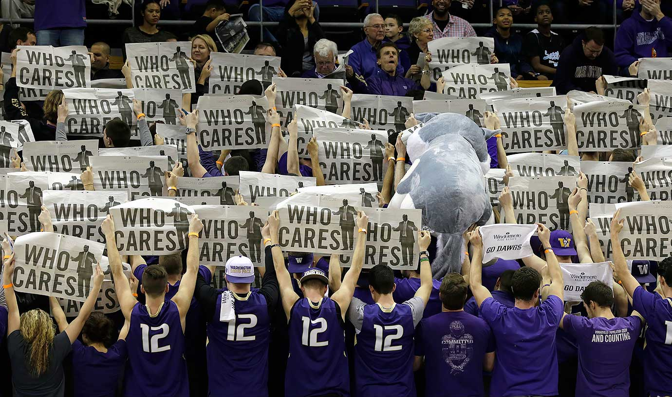 Washington Huskies student fans turn their backs during the introduction of Stanford players before a game in Seattle.