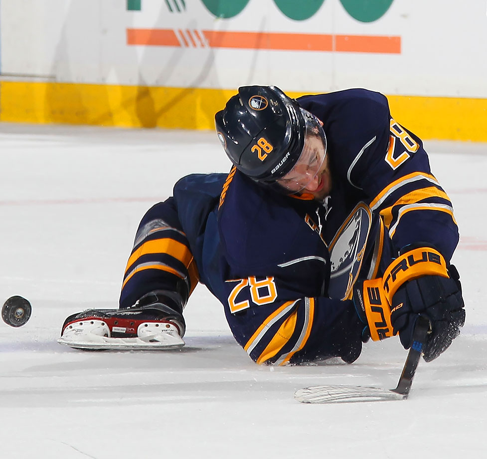 Buffalo Sabres center Zemgus Girgensons falls awkwardly to the ice after a collision during a game against the Pittsburgh Penguins in Buffalo, N.Y.