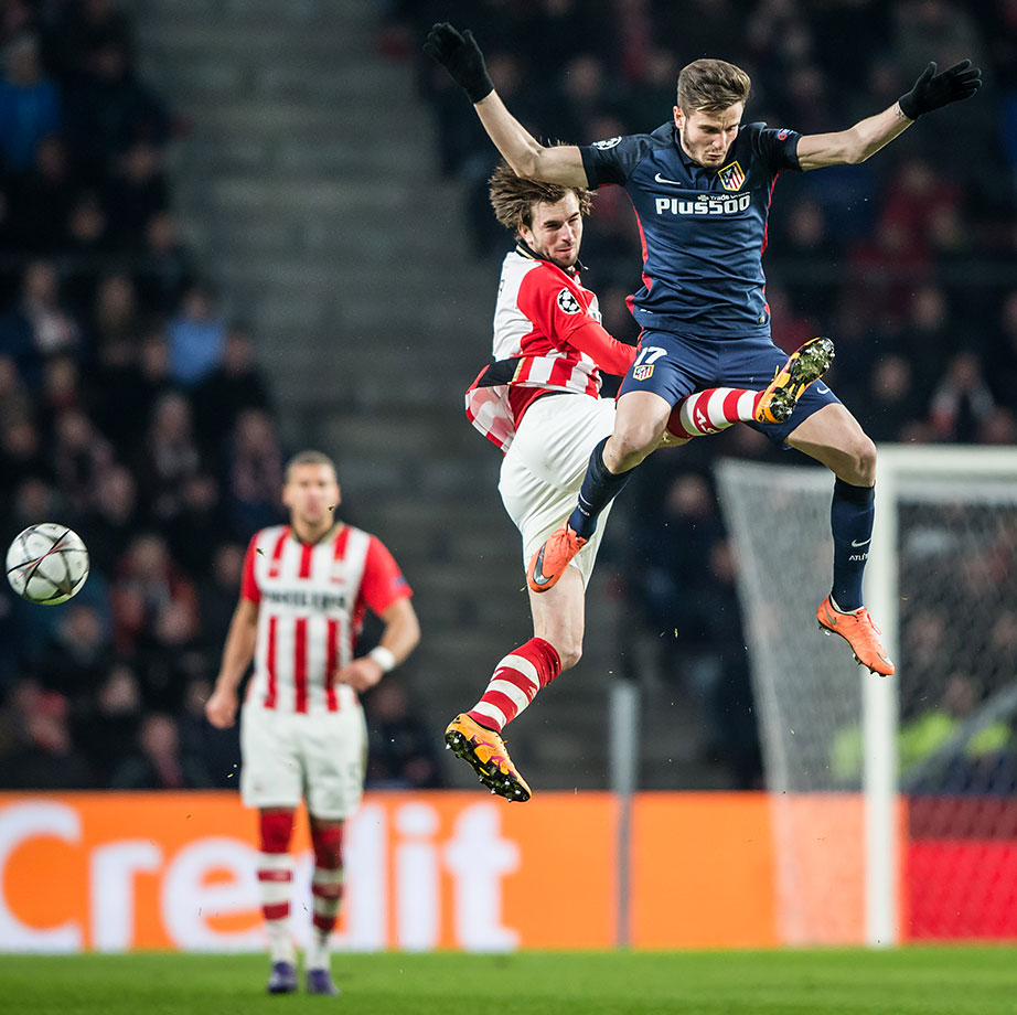 Saul Niguez of Madrid jumps for a header with Davy Proepper of Eindhoven during the UEFA Champions League Round of 16 First Leg match in Eindhoven, Netherlands.