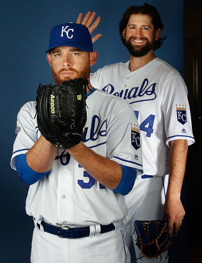 Pitcher Ian Kennedy of the Kansas City Royals poses for a portrait as Luke Hochevar steps in for a photo bomb during spring training photo day in Surprise, Ariz.