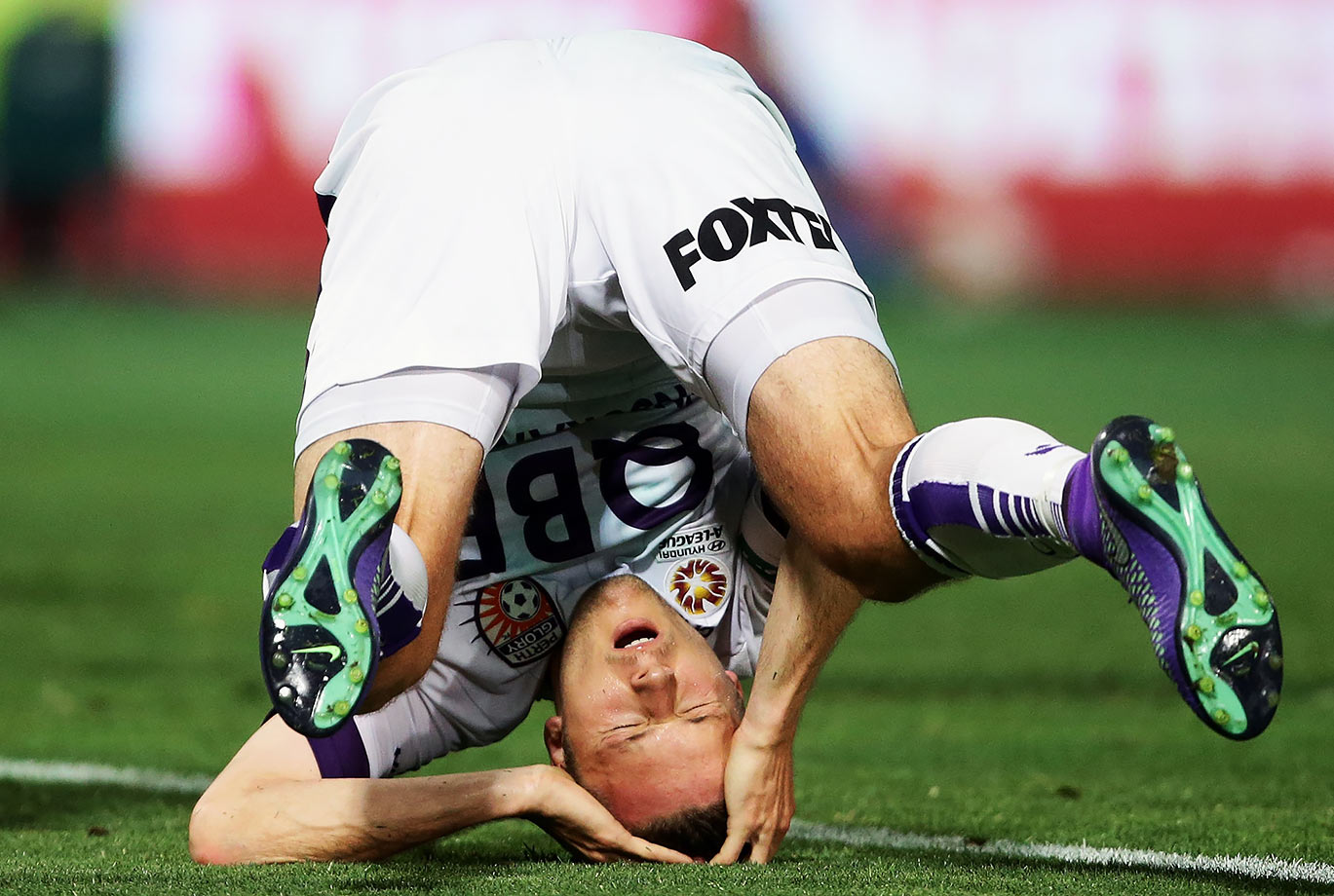 Chris Harold of Perth Glory falls over backwards and reacts after a missed opportunity on goal during the round 21 A-League match against the Western Sydney Wanderers in Sydney, Australia.