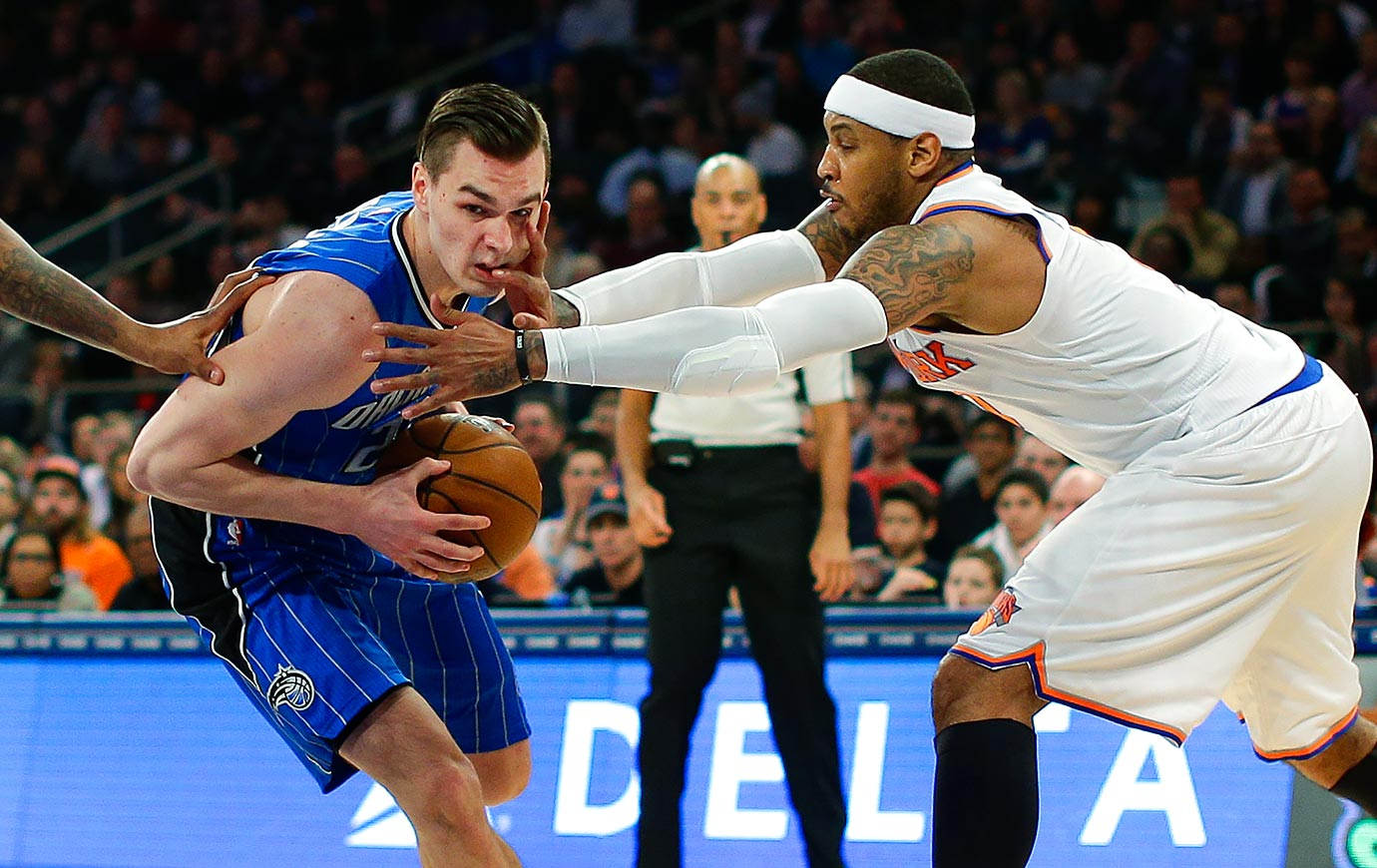 Orlando Magic guard Mario Hezonja drives past New York Knicks forward Carmelo Anthony during the second quarter of a game in New York City.