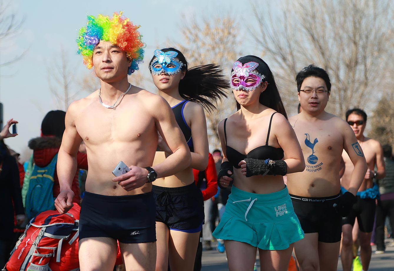 Participants run during the 2016 Beijing Undie Run at the Olympic Forest Park in Beijing, China.