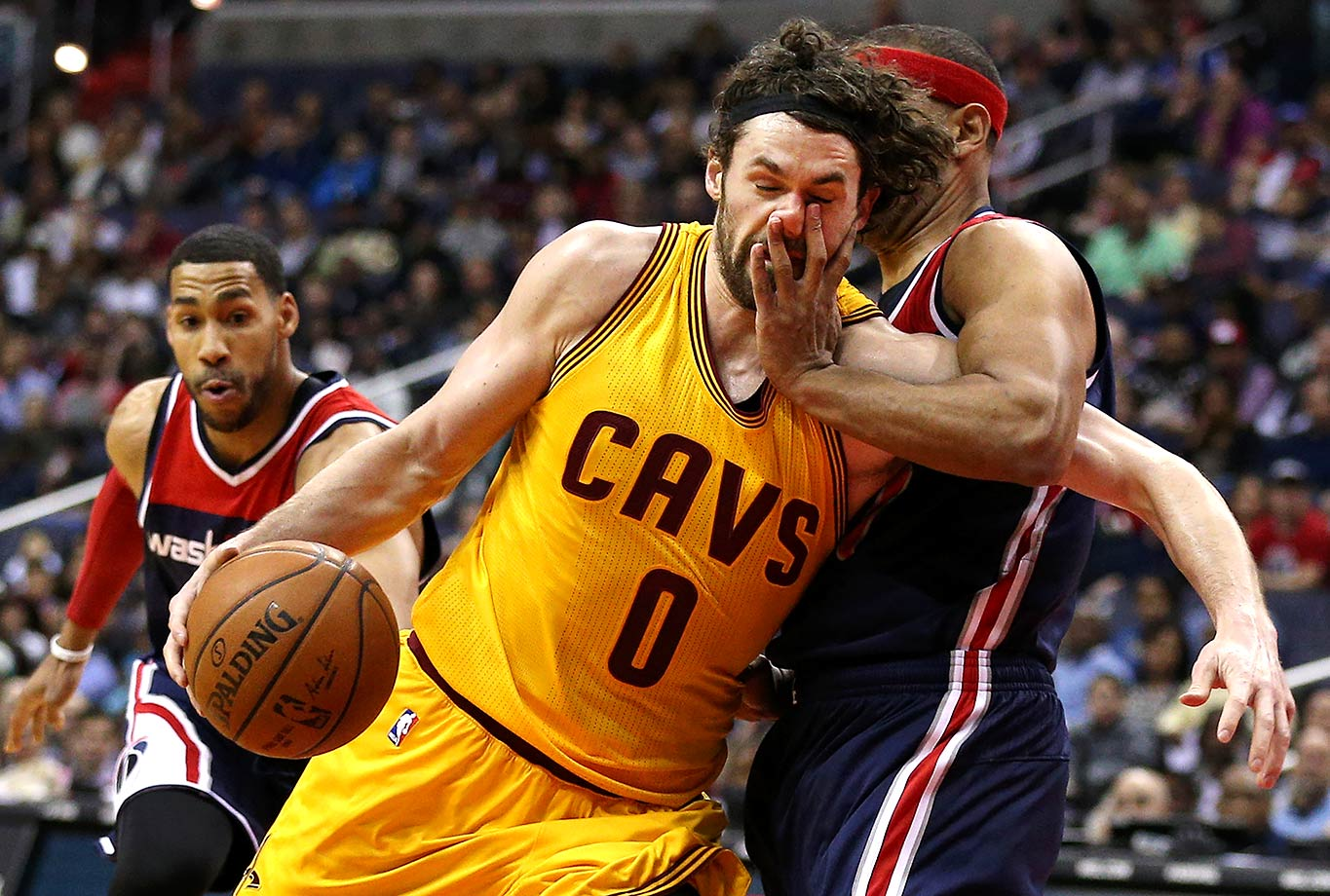 Kevin Love of the Cleveland Cavaliers is fouled by Jared Dudley of the Washington Wizards during the first half of a game in Washington, D.C.