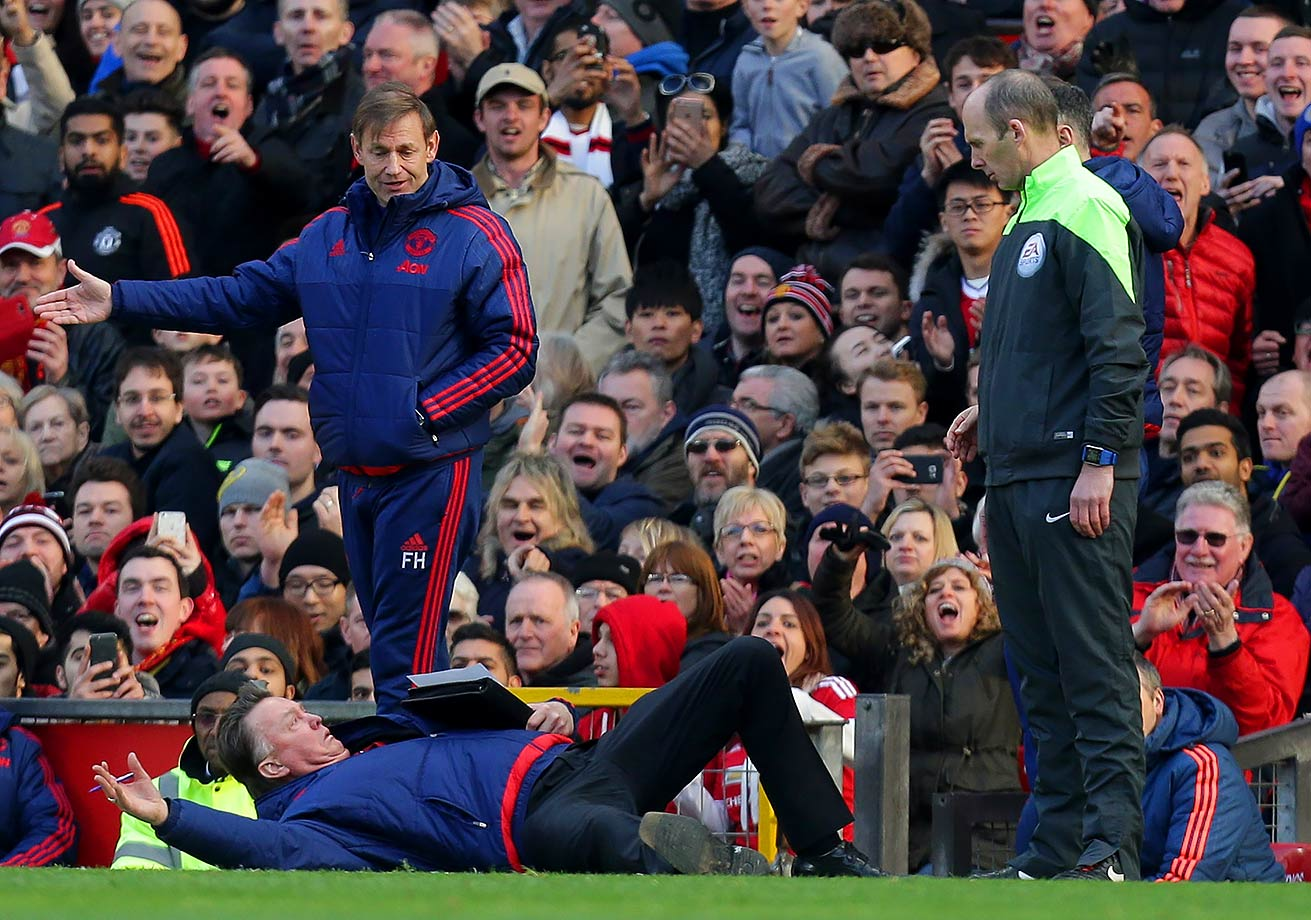 Manager Louis van Gaal of Manchester United remonstrates with the fourth official Mike Dean during the Barclays Premier League match against Arsenal in Manchester, England.