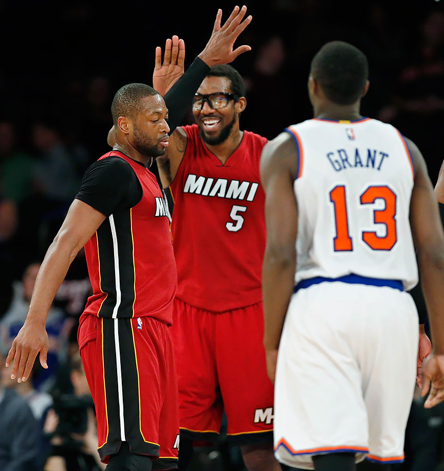 Miami Heat forward Amar'e Stoudemire attempts to high-five teammate, guard Dwyane Wade in the fourth quarter of a game against the New York Knicks in New York City.