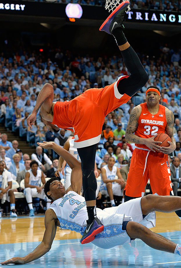 Michael Gbinije of Syracuse collides with Isaiah Hicks of North Carolina during a game in Chapel Hill, N.C.