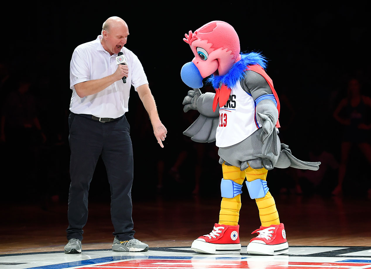 Los Angeles Clippers owner Steve Ballmer introduces their new mascot, a California Condor named Chuck, during halftime of a game against the Brooklyn Nets in Los Angeles.