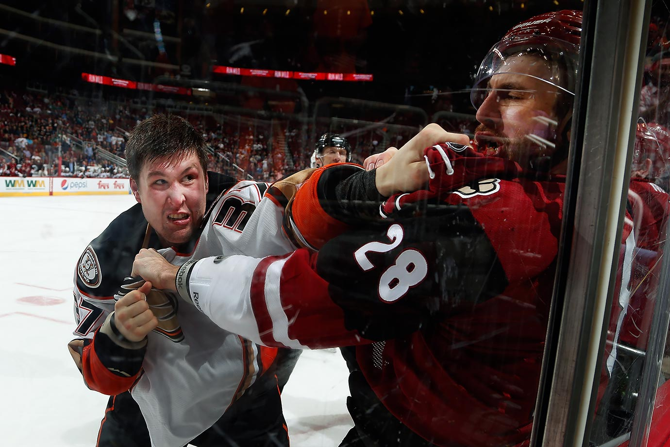 Anaheim Ducks left wing Nick Ritchie fights with Arizona Coyotes defenseman Jarred Tinordi during the third period of a game in Glendale, Ariz.