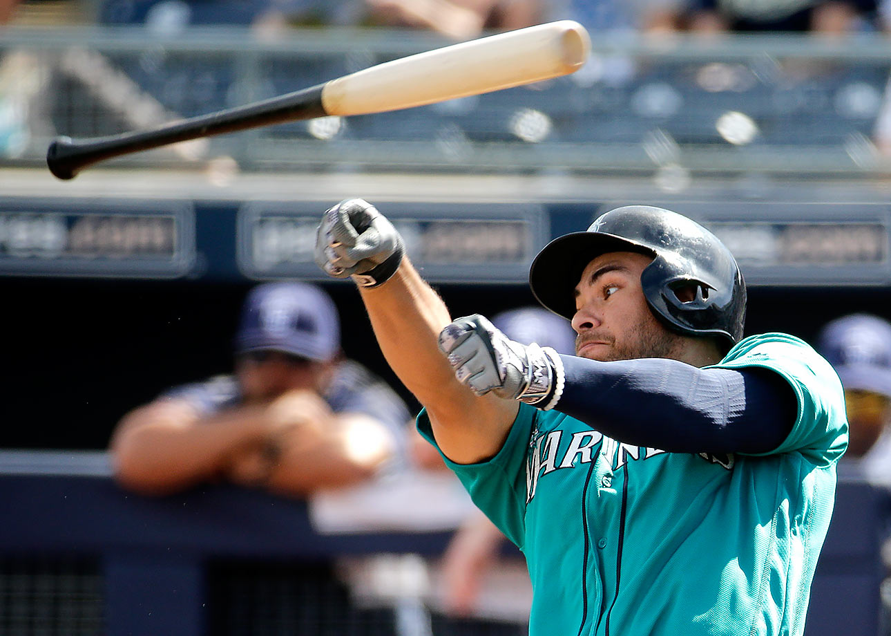 Seattle Mariners right fielder Stefen Romero loses his bat after taking a swing during the second inning of a spring training game against the San Diego Padres in Peoria, Ariz.