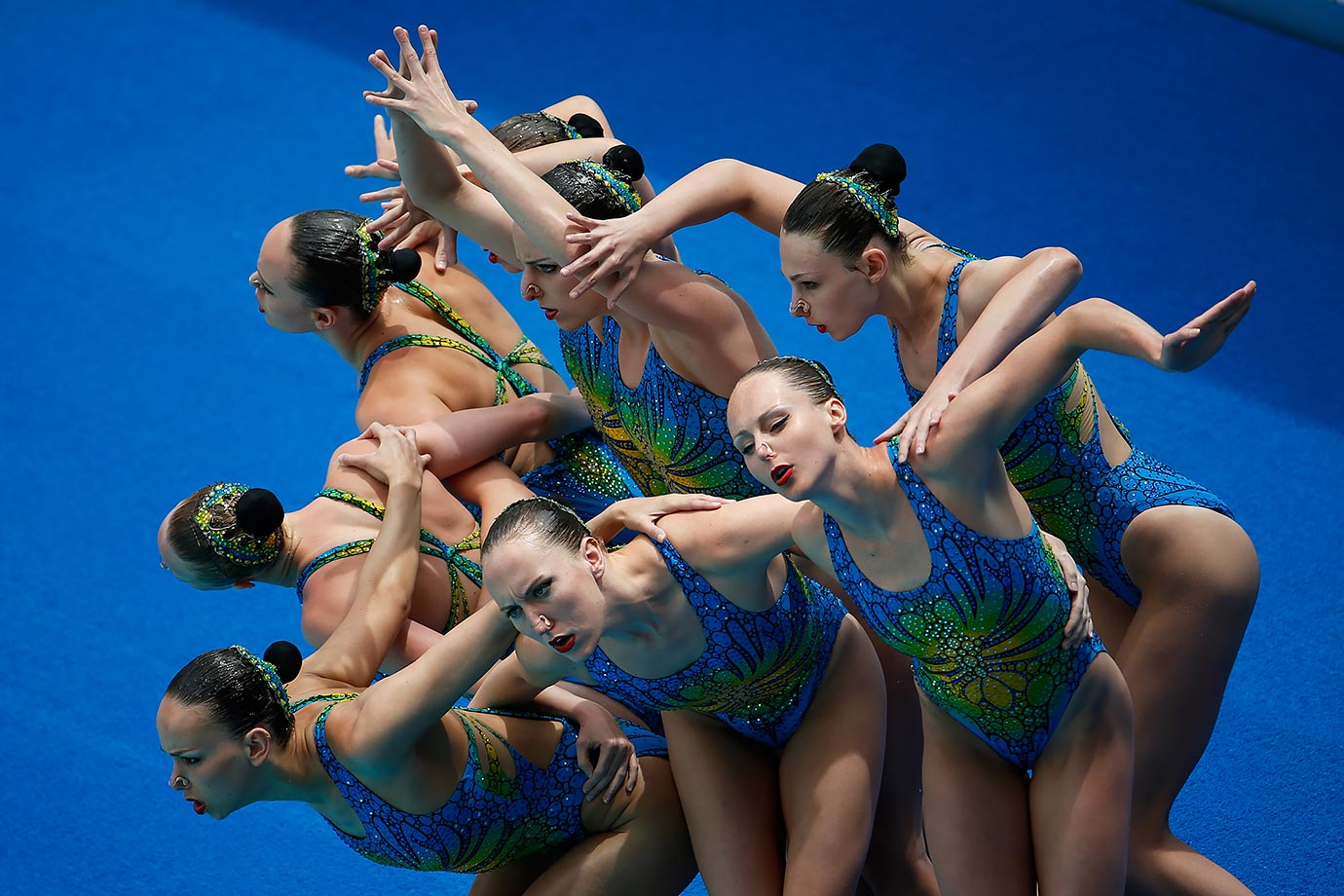 Canada's team performs their Technical Routine during the Synchronized Swimming Olympic Games Qualification Tournament in Rio de Janeiro, Brazil.