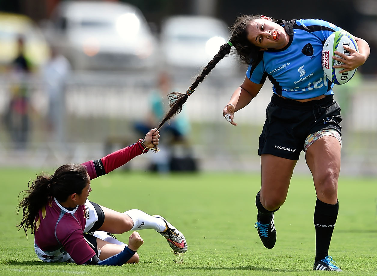 Maryoly Gamez of Venezuela pulls the hair of Victoria Rios of Uruguay during the International Women's Rugby Sevens - Aquece Rio Test Event for the Rio 2016 Olympics in Rio de Janeiro, Brazil.