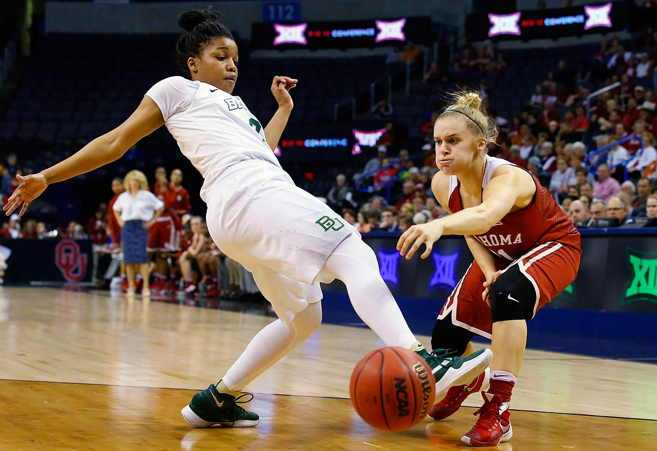 Oklahoma's Derica Wyatt passes the ball around Baylor's Niya Johnson in the second quarter of a Big 12 women's tournament game in Oklahoma City.